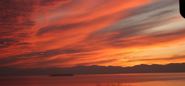 Sunset over Lake Champlain, with NY Adirondacks